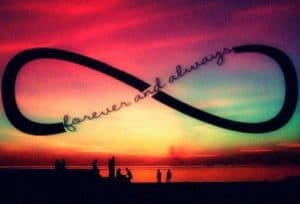 Infinity sign over colourful landscape and small dark images of people. Forever and Always built into the symbol